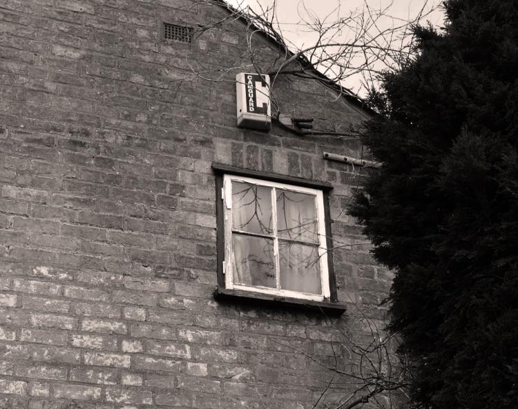 High window, writer's cell or dreamer's garrett?